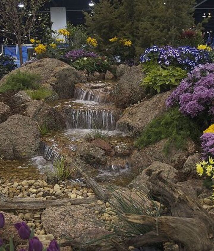Moss rock from Colorado enhances this beautiful pondless waterfall.