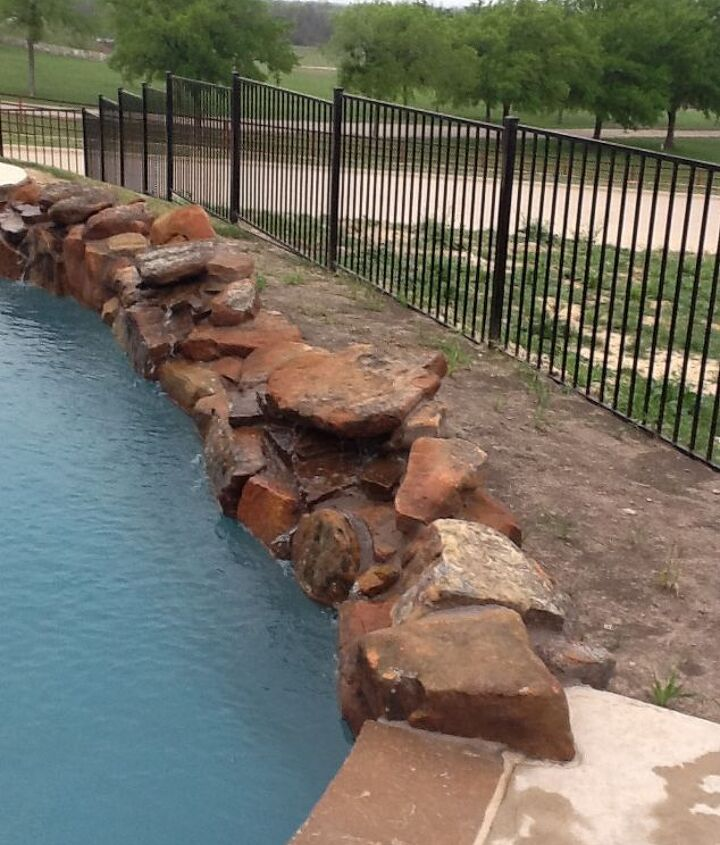 This is the backside of the pool. We would like to use small rock for covering. No idea what to plant. Remember this can be viewed by folks driving by.