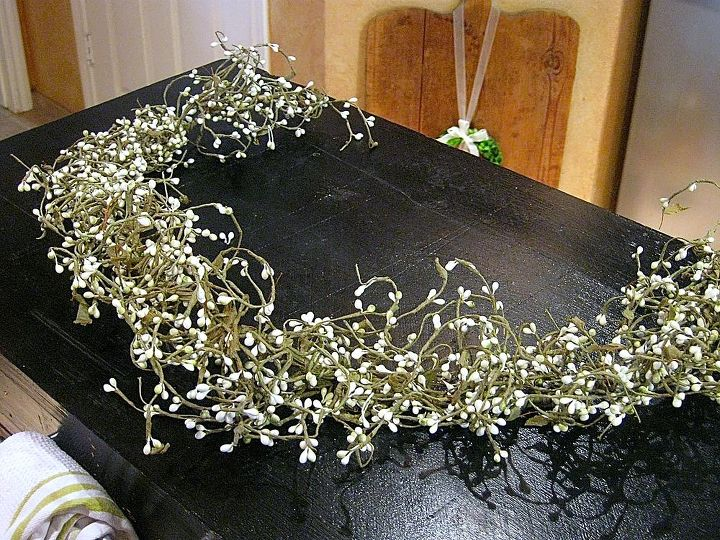 and attached a garland of white pip berries to the styrofoam back.....