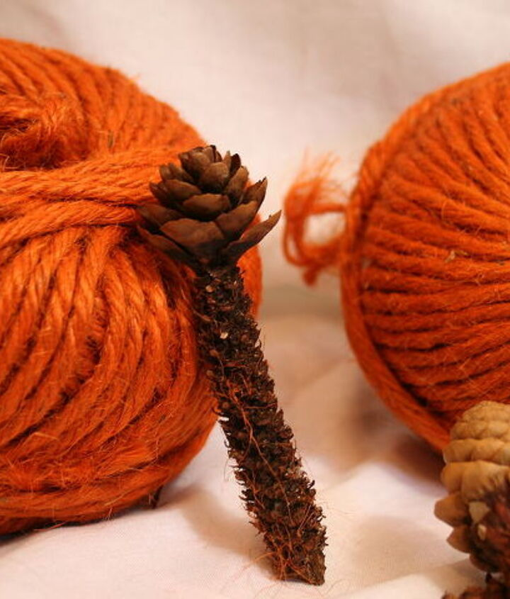 balls of yarn and pinecones