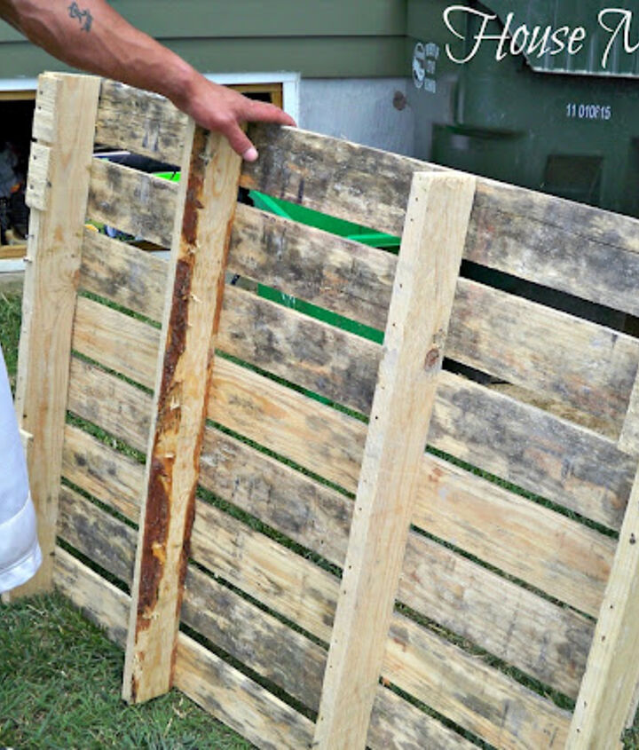 He started by taking the pallets apart and saving the existing nails to re-use later.
