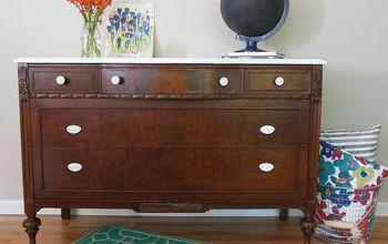 A Dark Wood Dresser With a White Top