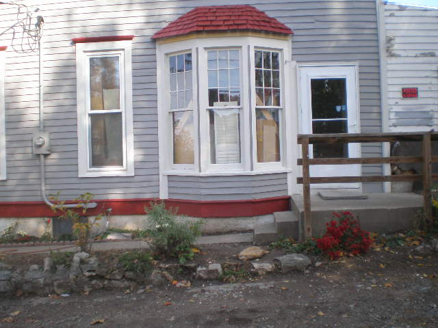we added shake shingles to match the ones on the trim detail in the front of the house.