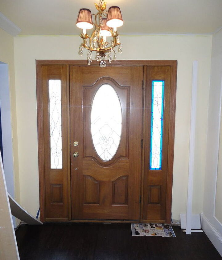"This is the BEFORE.  It is a very nice door - but it was just boring.  Dated honey oak with brass sidelights.  It just needed a little ""something""."