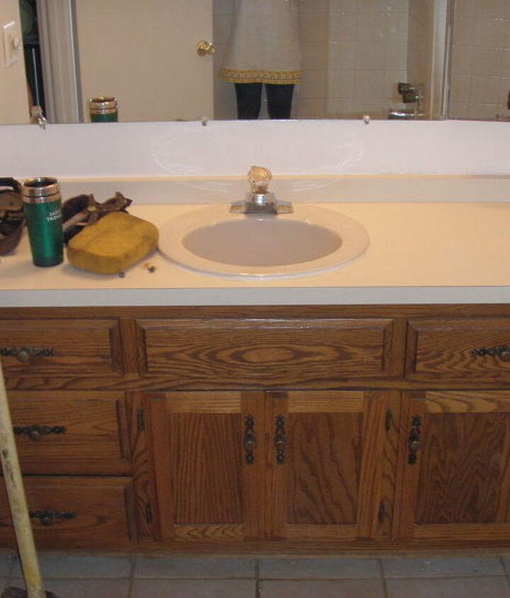 Hallway Bathroom Vanity Before  Note:  New handles, but spray painted the hinges