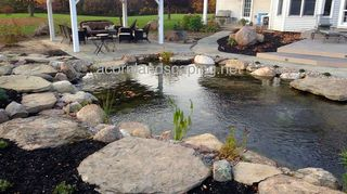q can anyone give me some good reasons to get a pond just asking, ponds water features, Here s a backyard pond we constructed Acorn Landscaping in Rochester NY last year Is anyone thinking about getting a pond installed this year