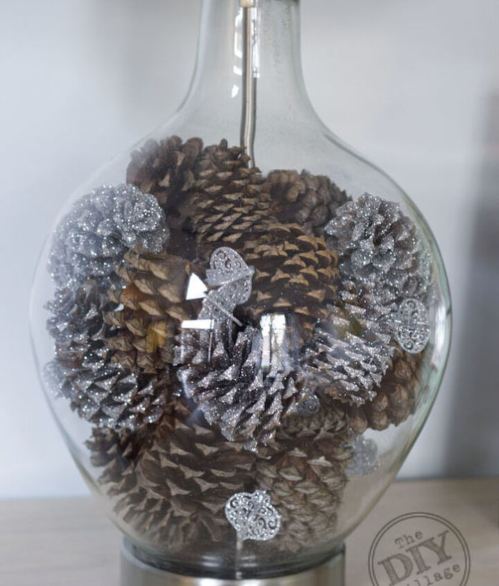 Fill the base of your lamp with glittered and regular pine cones.  Throw some small glittered ornaments into the mix for an extra touch.