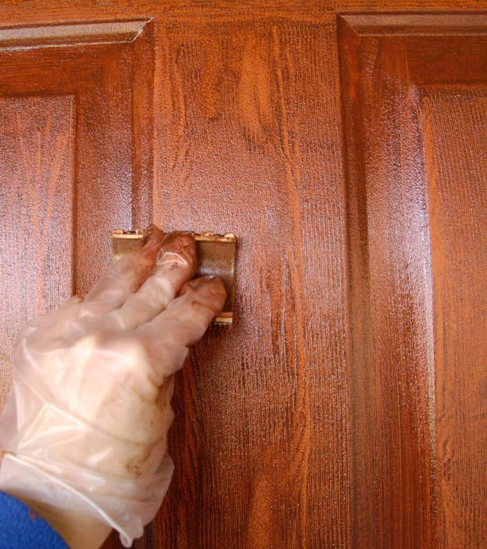 Here I am in the process of applying the stain and using the wood grain tool to create a realistic wood pattern.