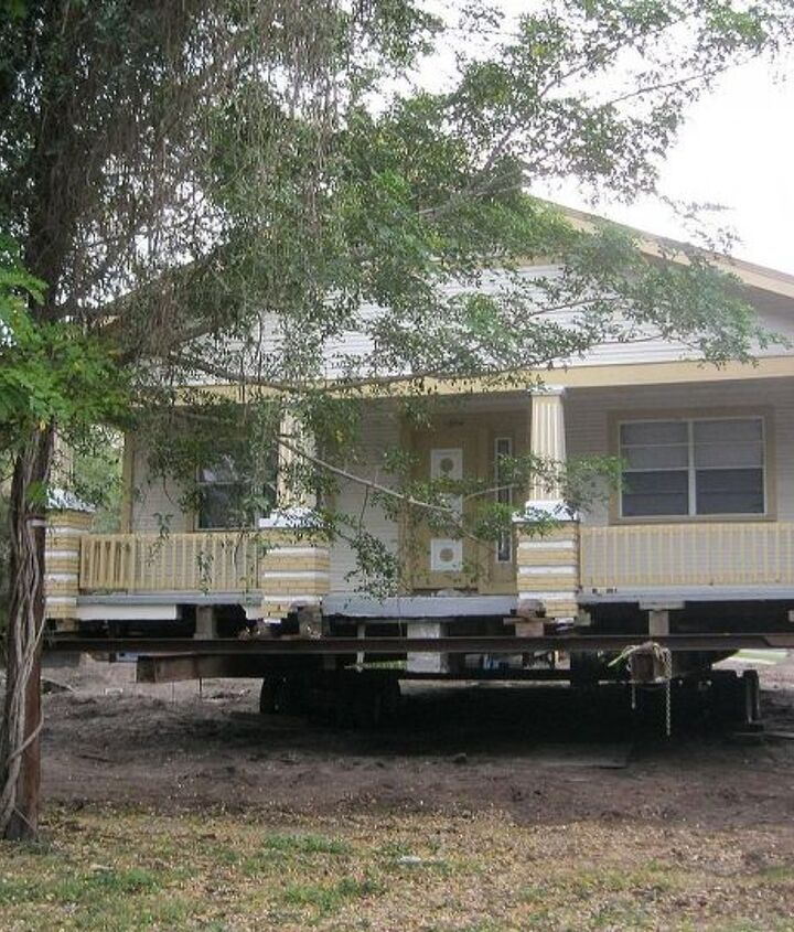 The house is loaded onto steel beams and wheels
