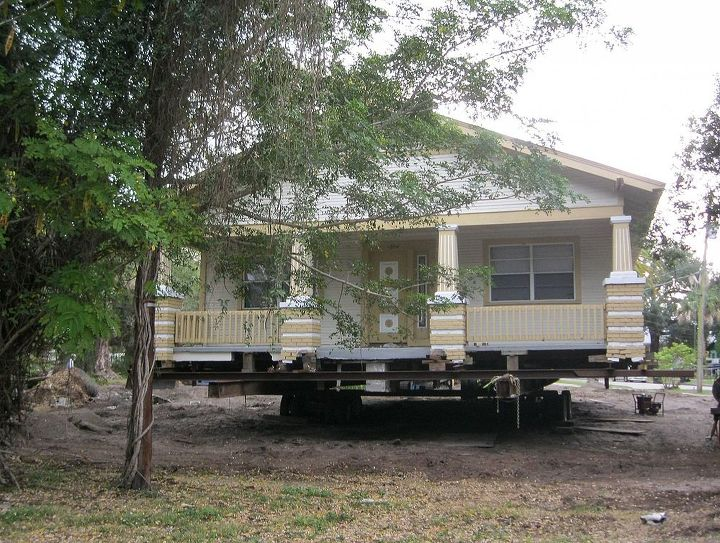 a house move, architecture, The house is loaded onto steel beams and wheels