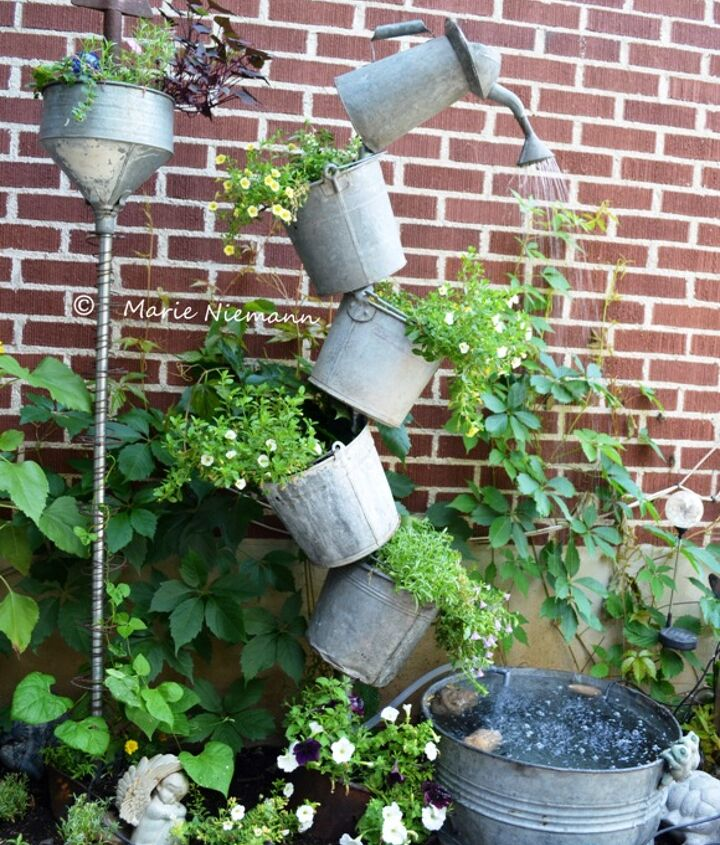 """Marie Niemann tells how she did this project,...mostly by herself! She says, """"I finally finished it! Inspired by my good friend and Flea Market Gardening contributor and artist Annie Steen with her tipsy galvanized water feature."""""""