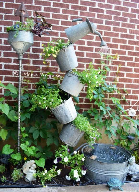 "Marie Niemann tells how she did this project,...mostly by herself! She says, ""I finally finished it! Inspired by my good friend and Flea Market Gardening contributor and artist Annie Steen with her tipsy galvanized water feature."""