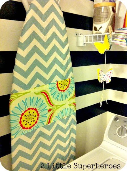 My boring ironing board got a new cover with some scrap fabric.