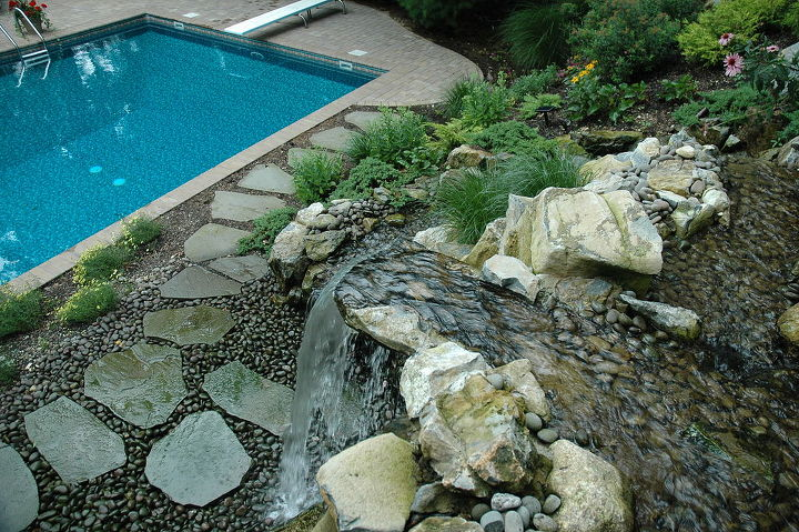 View of the top spill stone and bluestone path around the back side of the swimming pool. Project by Deck and Patio Company Huntington Station New York. Read more- http://www.deckandpatio.com/DP_Blog/?p=1013