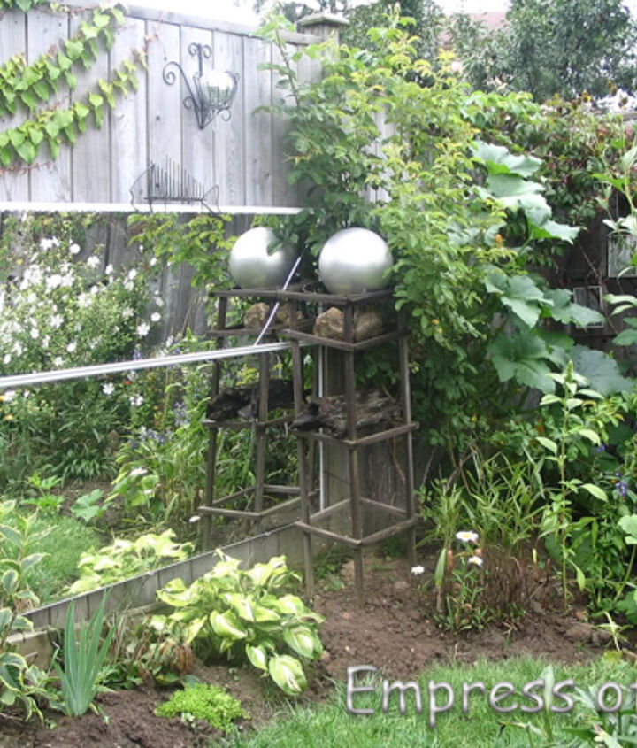 Two mirrored showered doors add interest to the back corner of the garden.