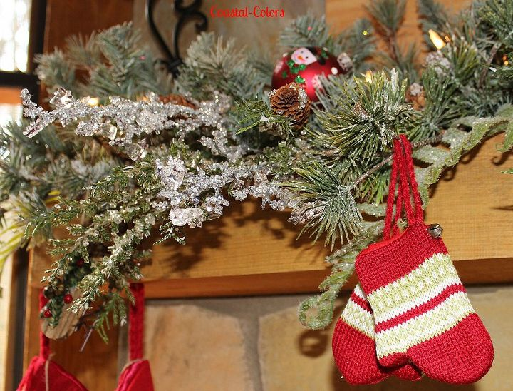 Stocking, mittens and sleds are woven into the garland.