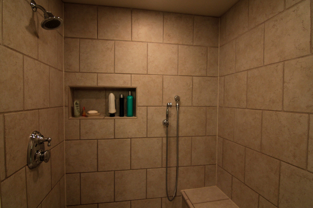 We usually incorporate a tile shampoo niche to maximize space and convenience for clients.