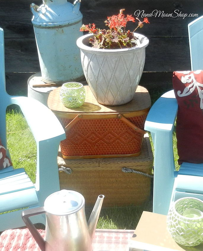 For an end table, I stacked vintage picnic baskets.