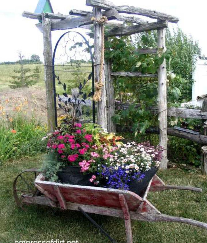 Classic old wheelbarrow filled with colour: http://www.empressofdirt.net/gardencontainerideas/
