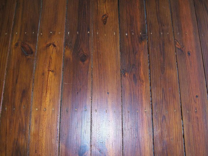 This floor is inside the screened porch. It had a solid stain that was sanded off and re-stained with Natural Oak by Sikkens. It is darker due to the previous stain that penetrated the wood.