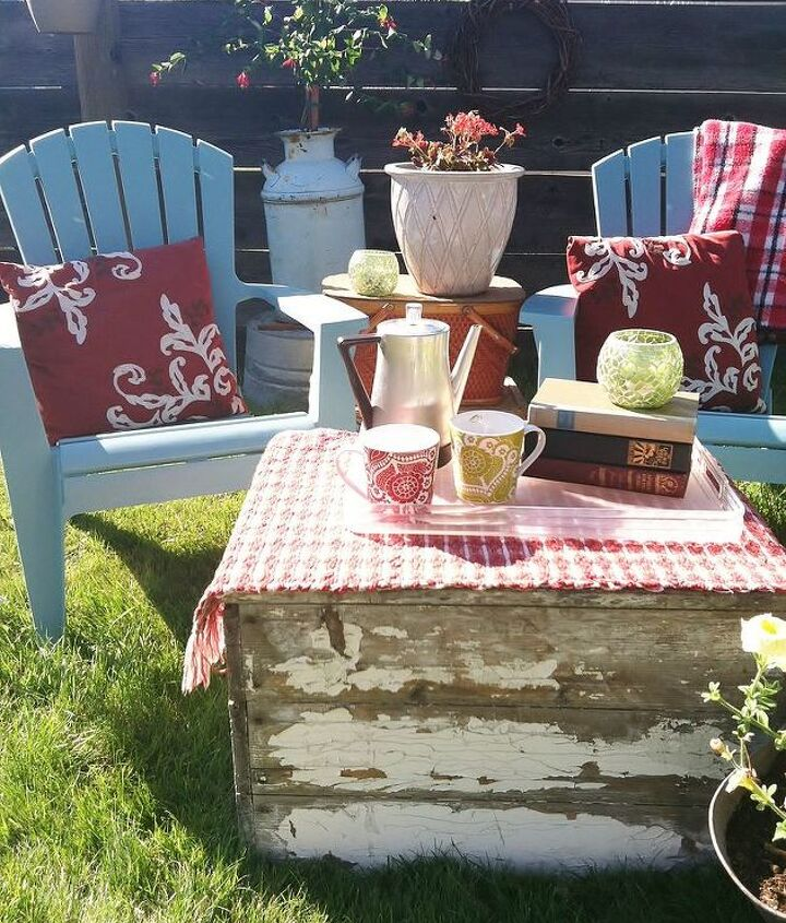 Lots of repurposed items make up this cozy outdoor seating area. I fill my vintage coffee pot with iced coffee and louge here on a warm summer evening.