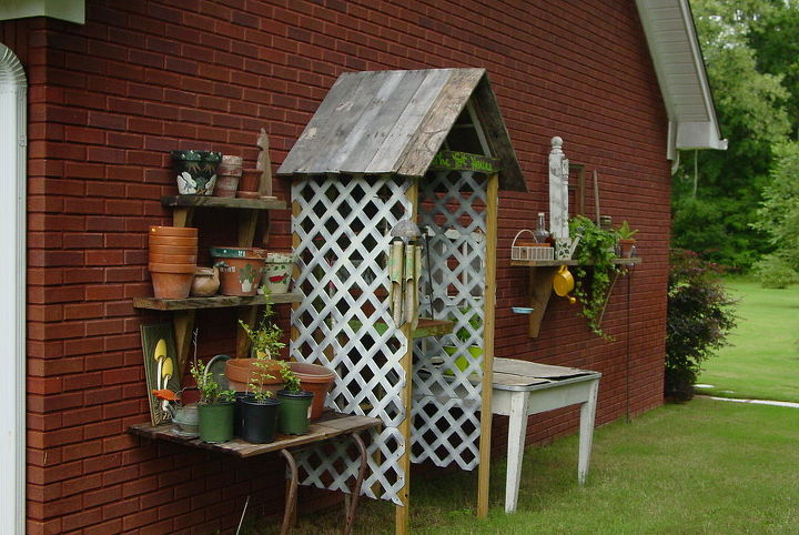 a stroll to my potting area with camera in hand, gardening, outdoor living, repurposing upcycling, Recipe Old windows pallet wood and some leftover boards from house building Add some brain storming and creativity mix it all together and you have a potting area