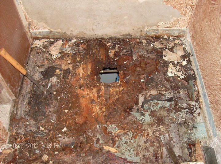 old floor with water damage from toilet leaking.