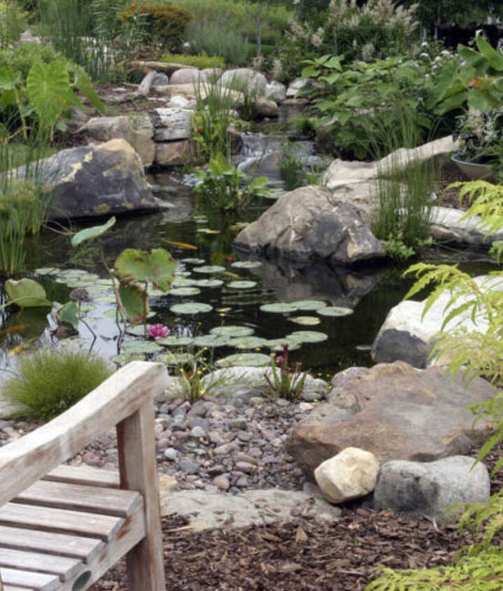 A variety of rock shapes and sizes makes this new pond look like it's been there for years.