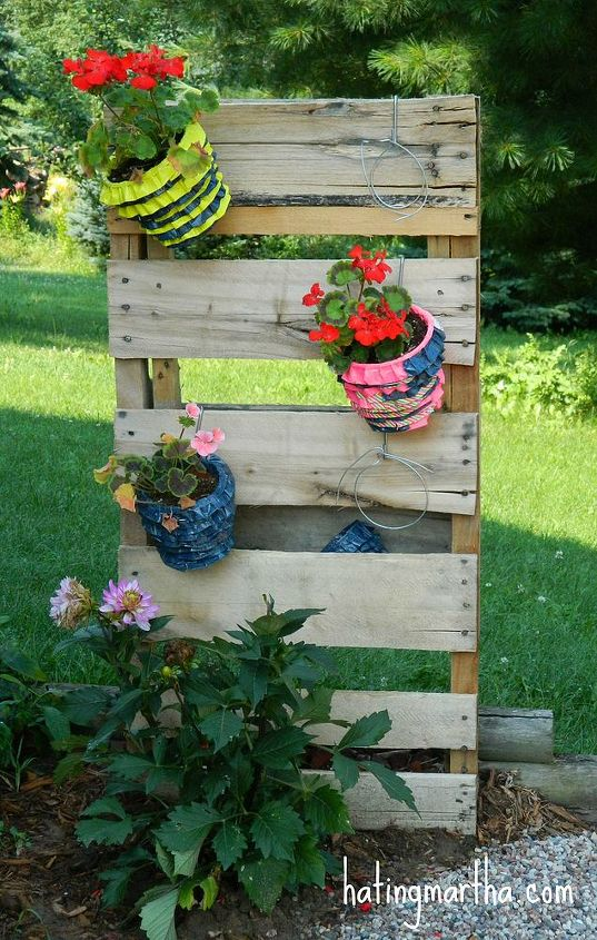 1/2 a pallet, some wire, and s hooks makes for a fun planter holder!
