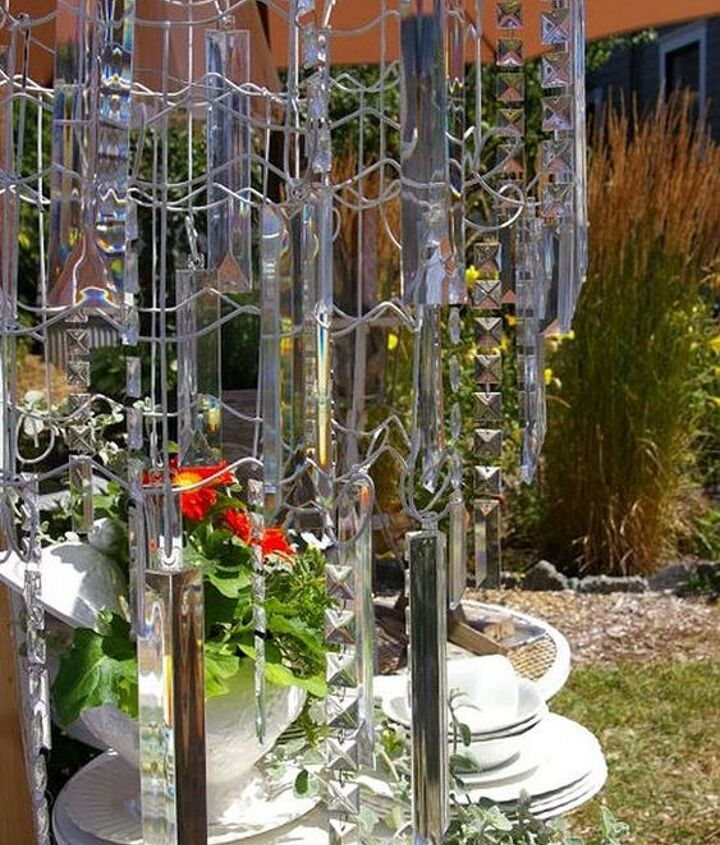 Concentric circles of fencing create a tiered chandelier with dripping resin crystals. http://homewardfounddecor.blogspot.com/2013/05/a-garden-fence-chandelier.html