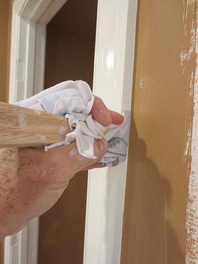 To make the line even straighter, take your 5-in-1 tool wrapped with a wet rag and drag it down the corner.  At just the right angle, this will give you a crisp, straight line.
