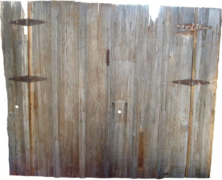 Old barn wood doors disassembled and reassembled to make a king size headboard