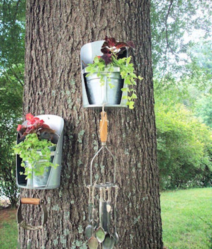 Feed grain scoops (again with MWHP's idea of placing them on the tree) with our favorite wind chimes we made from flattened spoons and vintage kitchen tools. (they sound so very pretty!)