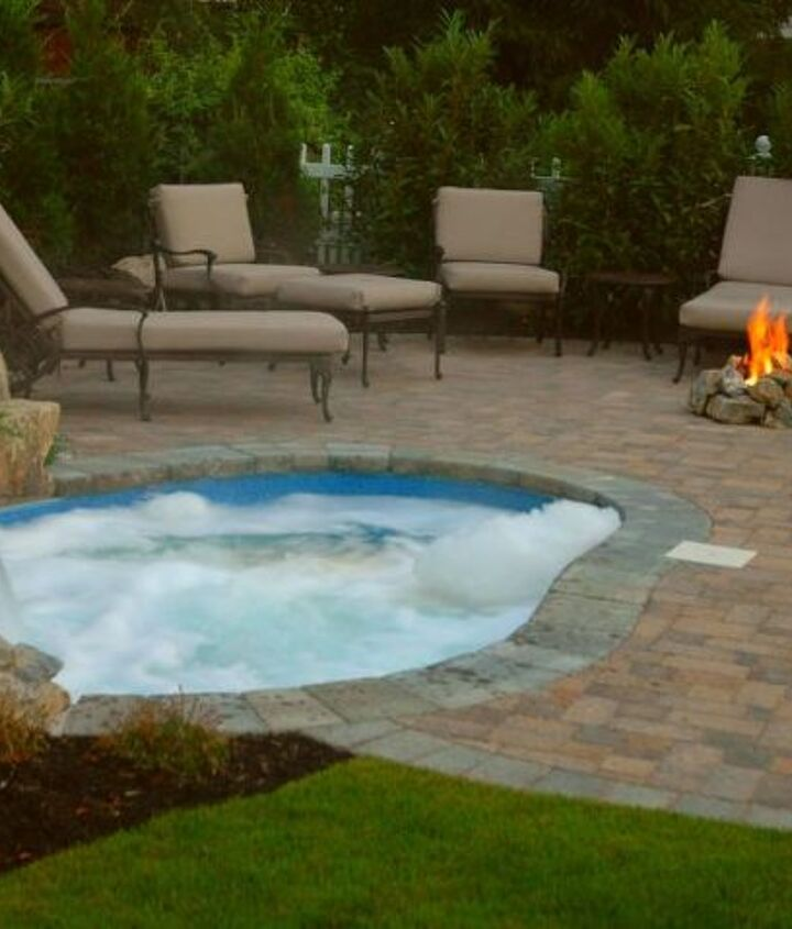 """Paver patio with a """"spool"""" pool and spa in one with waterfall and gas fire pit. http://www.deckandpatio.com/DP_Blog/?p=1105"""
