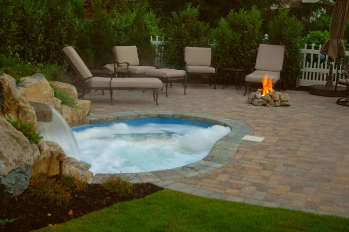 "Paver patio with a ""spool"" pool and spa in one with waterfall and gas fire pit. http://www.deckandpatio.com/DP_Blog/?p=1105"