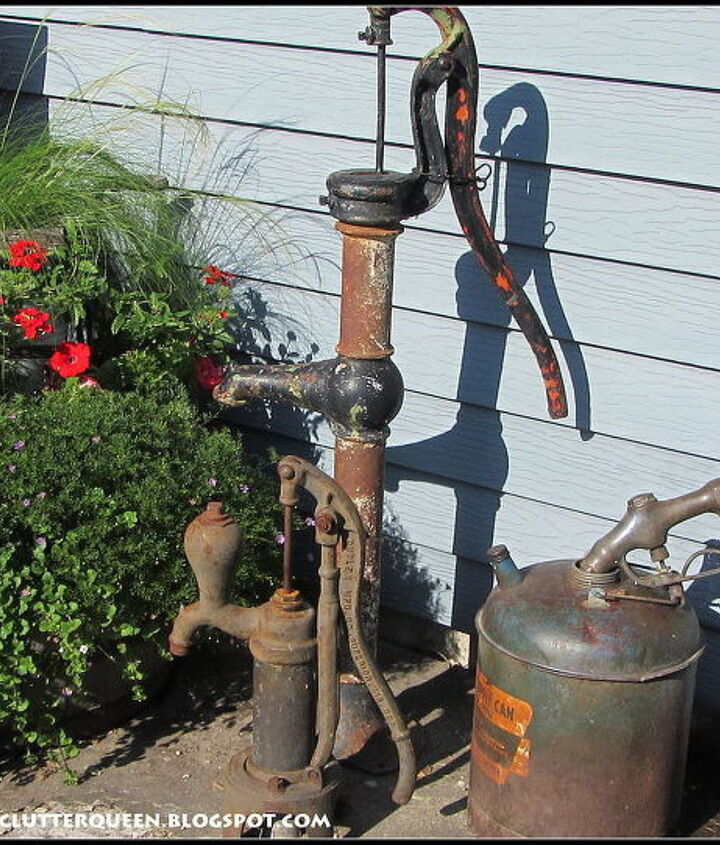 On the far right side of the potting bench are my vintage water pumps, an old metal gas can and vintage gas nozzle.