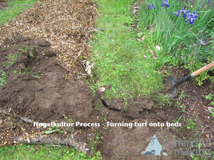 Flipping the turf for soil and pathways.