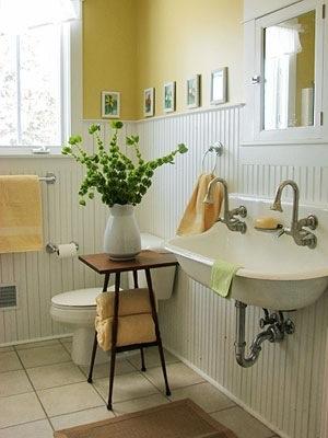 A gorgeous yellow Farmhouse bathroom.
