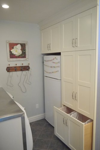 Extra fridge and pull out laundry hamper and lots more storage.