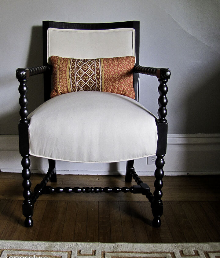 After with another pillow. This chair looks great with all kinds of pillows since the lines are so classically cool!