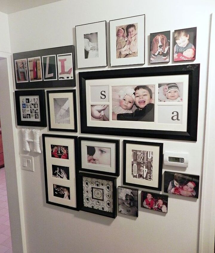 Our huge gallery wall, all finished.  No extra nail holes needed!  http://www.madincrafts.com/2013/01/easy-trick-for-hanging-large-photo.html