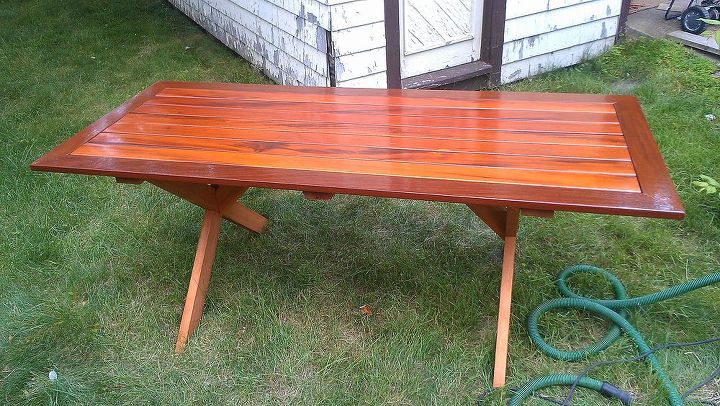 With the use of various size exterior screws and a drill to pre-drill pilot holes, I assembled the table board and batten style. The legs and cross bar are fastened into battens. Now the top is hand sanded with 220 and oiled again.