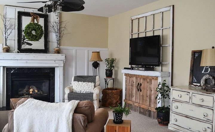 More open floor space and I like the mix of woods and whites with black accents..