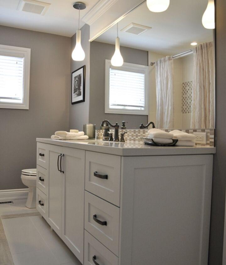 New custom vanity, mosaic tiles used for backsplash and on tub wall