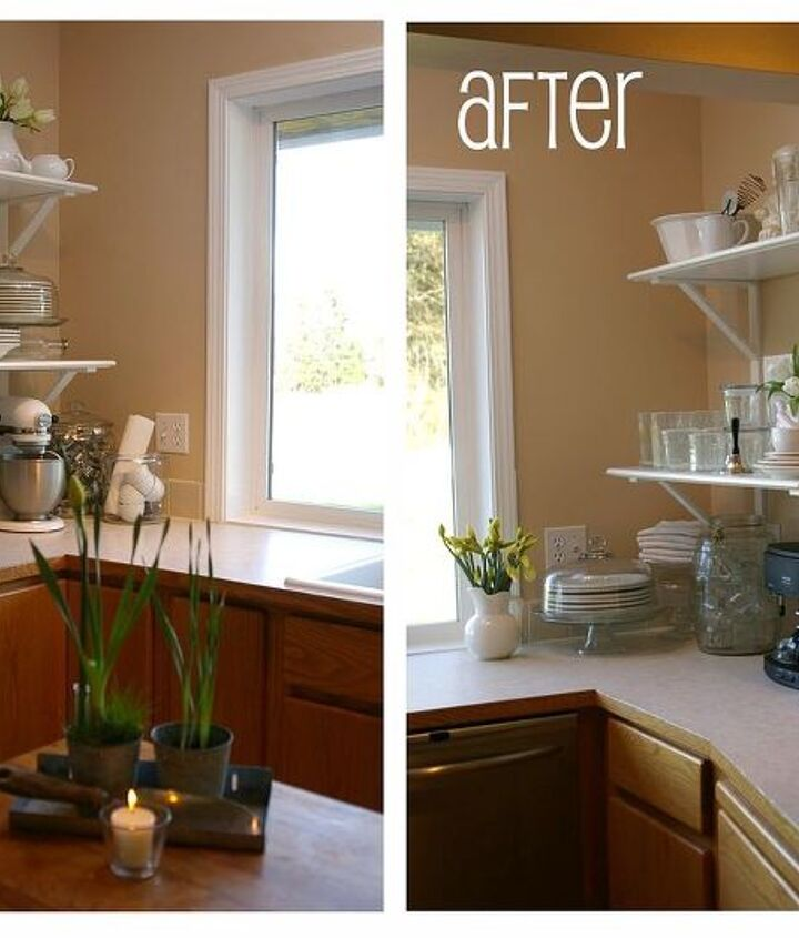 there are MORE dishes being stored on these shelves than ever fit in the previous four cabinets! it's open, light, and stylish. (and the window looks larger with white trim!) Base cabs were to be painted white in the next phase.