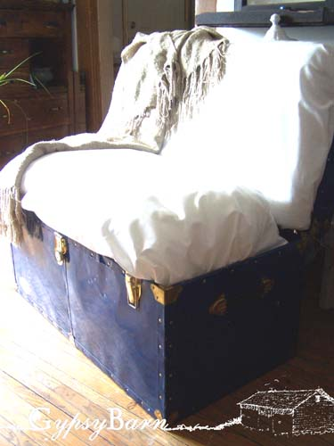 Sette. Create an inner skeleton, add a bench seat in there that flips up, 6 inch foam on the base, 4 on the back, covered with a lot of fluffy stuffing then some great fabric. Storage bench - settee!