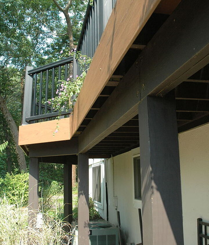 "Tip: Dark brown stain on framing gives a clean ""floating"" effect to the raised deck. http://www.deckandpatio.com/decks/portfolio.html"