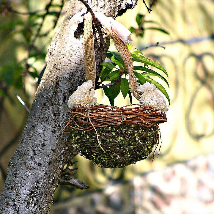 An old flower girl basket has been repurposed as garden decor.