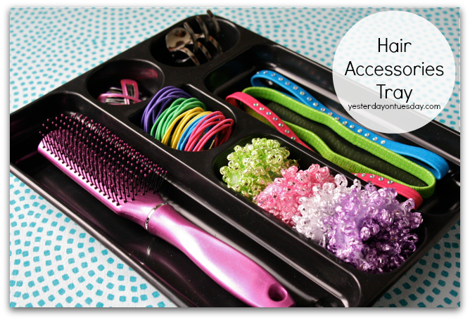 Organizing Solution #3: Hair Accessories TrayRepurpose a plastic desk tray into a chic Hair Accessories Tray. It's got the perfect compartments to hold a brush, headbands, ponytail holders and more.