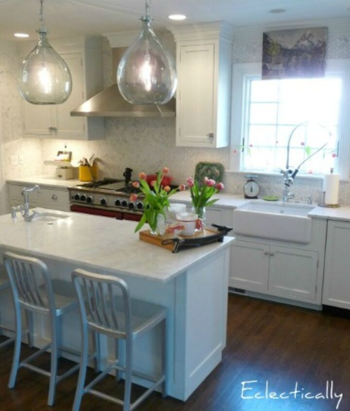 White cabinets and marble counters never go out of style. See entire kitchen here:  http://eclecticallyvintage.com/2012/02/kitchen-tour-renovation-white/